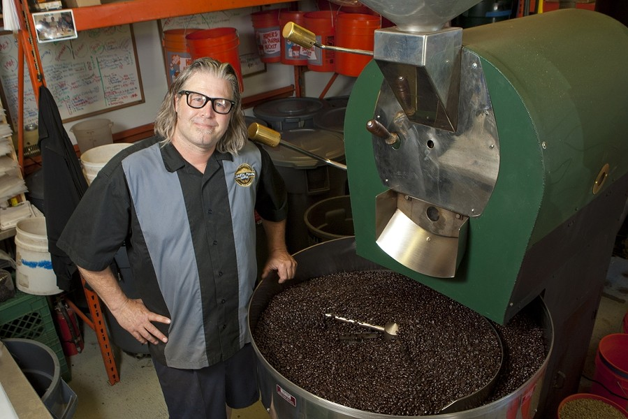 LOCAL ROAST:  Phil Grant, Roastmaster for Coastal Peaks Coffee, roasts coffee with knowledge and pride for customers all over the Central Coast. - PHOTO BY STEVE E. MILLER
