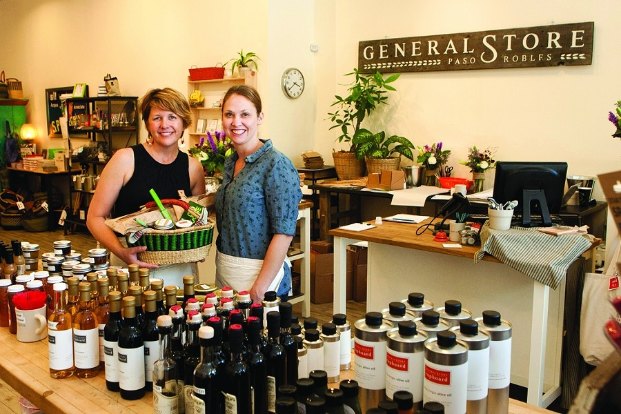 GENERALLY COOL :  Downtown Paso Robles now has a store full of goodies for awesome picnic baskets (like the one Joeli Yaguda is holding on the left next to Jillian Waters) or for general household usage. - PHOTO BY STEVE E. MILLER