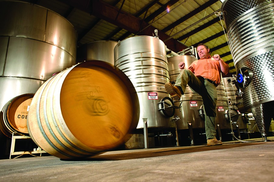KICKIN' IT :  Mike Sinor, one of many winemakers participating in the annual Roll Out the Barrels celebration, showcased his barrel rolling skills for New Times. - PHOTO BY STEVE E. MILLER