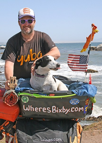 PEDALING FOR PAWS:  Mike Minnick and his shelter dog Bixby were regulars around SLO until late May. The pair has spread their message of rescue dog adoption and is now moving onward across the country. - PHOTO BY HAYLEY THOMAS
