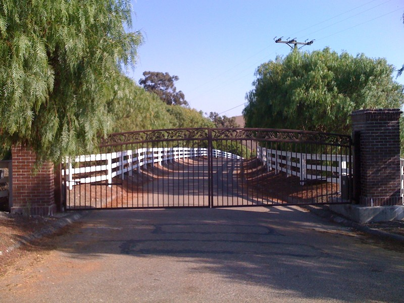 SLO OR SANTA BARBARA :  The gate to the Suey Ranch is currently in SLO County, but could become part of Santa Barbara unless one more supervisor protests the transfer. - PHOTO BY COLIN RIGLEY