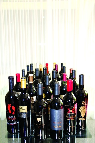 POP A CAB IN YOUR GLASS :  During a tasting of 28 cabernet sauvignon and - cabernet blends in Paso Robles—all members of the Paso Robles CAB Collective—the judges found many outstanding 2010 and 2011 wines. - PHOTO COURTESY OF PARKER SANPEI