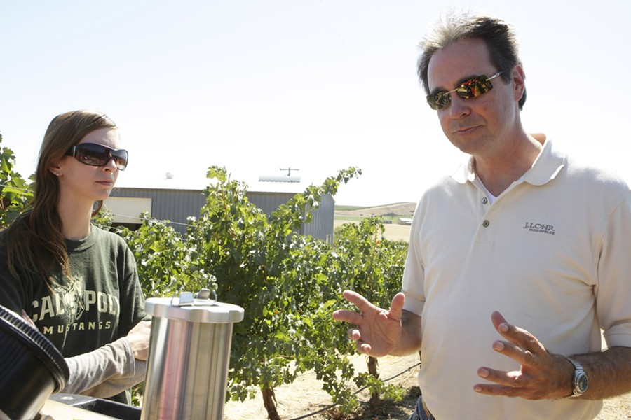 "WATER CONSERVATION IN ACTION :  Steve Lohr (right) of J. Lohr Vineyards & Wines shows Cal Poly intern Katherine Malin (left) how to use ""pressure bombing"" to determine irrigation schedules. - PHOTO BY STEVE E. MILLER"