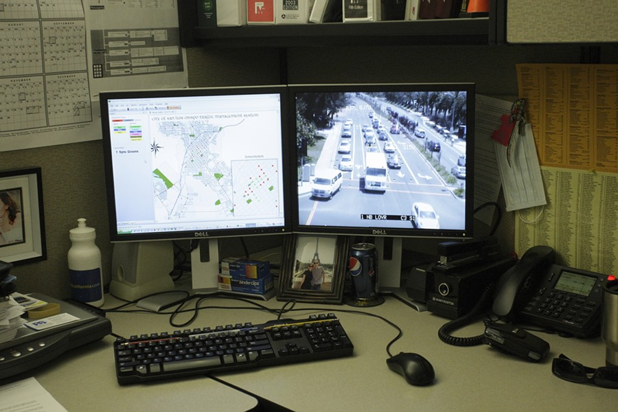 TOTAL CONTROL :  From his cubicle in the SLO Public Works Department, Senior Traffic Engineer Jake Hudson can at any time access video feeds from traffic cameras throughout the city. - PHOTOS BY STEVE E. MILLER
