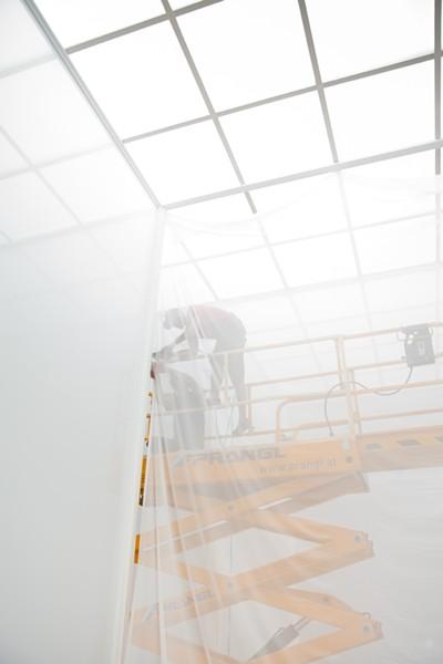 Jeff Jamieson works on Robert Irwin's installation piece Double Blind at Secession in Vienna, Austria. - PHOTO BY DEBORAH DENKER