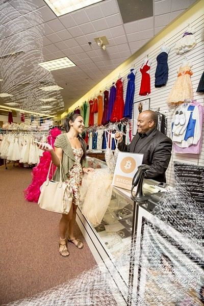 DIGITS BECOME DRESSES:  Benjamin Vigil, owner of Apple Tree Dress in Santa Maria Town Center East, has begun accepting Bitcoin as payment for the dresses, tuxedoes, and accessories he stocks. - PHOTO ILLUSTRATION BY HENRY BRUINGTON