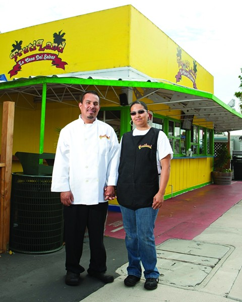 FAMILY FOOD:  Jose and Grissel Rojas, owners of Frutiland—La Casa Del Sabor, stand proudly in front of their small restaurant where they make food with big flavors. - PHOTO BY STEVE E. MILLER