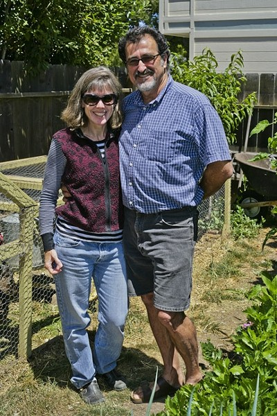 DREAMERS:  Liz Rhoads Cordoba and George Griffin enjoy the fruits of their labor in their extensive backyard garden. - PHOTO BY GLEN STARKEY