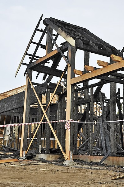 REMAINS:  An Nipomo house fire on April 5 destroyed an unfinished structure intended for farmworker housing under H-2A, a government program for temporary foreign farmworkers. - PHOTO BY CAMILLIA LANHAM
