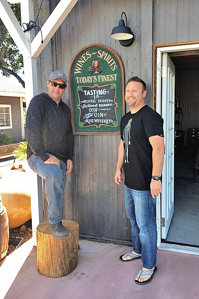 BUDDIES:  From left: Joe Barton of Grey Wolf Winery and Barton Family Wines and Stephen Kroener of Silver Horse Winery have come together to open KROBĀR Craft Distillery in Paso Robles. - PHOTO BY HAYLEY THOMAS