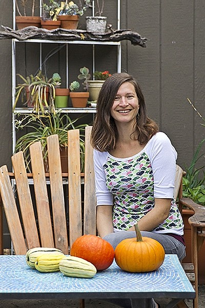 GREEN DREAM:  Roxanne's Cafe owner Roxanne Lapuyade encourages diners to not only nosh, but relax, rejuvenate, and recharge at her green garden patio tucked just off Archer Street behind the Smiling Dog Yoga studio in SLO. - PHOTO BY JAYSON MELLOM
