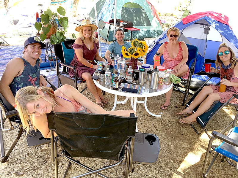 LIVE OAKIES! (Clockwise from bottom) Rakesha, Casey, Melinda, Ryan, Anna, and Micki find a shady spot during a hot 29th annual Live Oak Music Festival. - PHOTO BY GLEN STARKEY