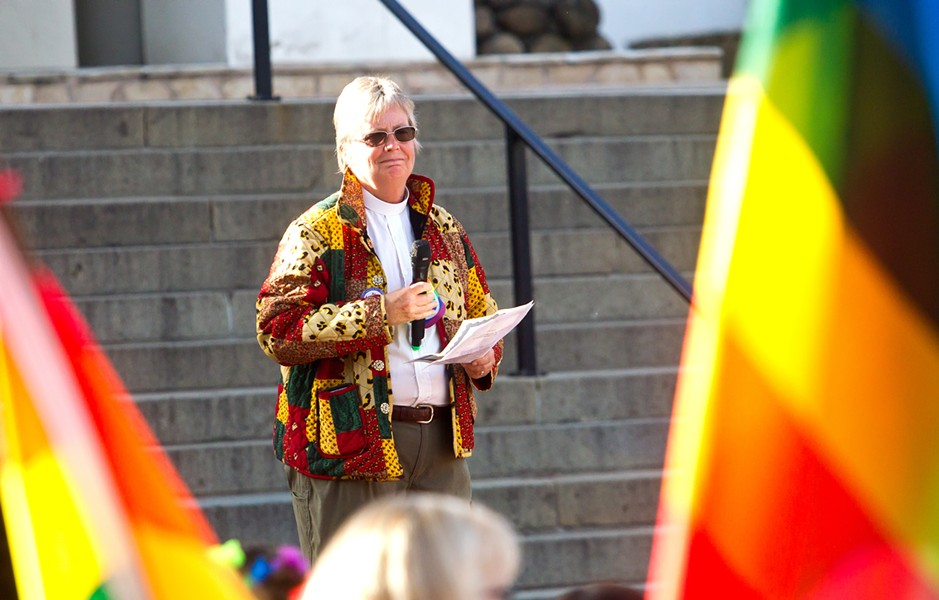 COLLABORATE The Rev. Caroline Hall speaks at the June 7 LGBT rally in Mission Plaza. Hall is one of several local pastors working to create a welcoming community of faith in SLO County. - PHOTO BY JAYSON MELLOM