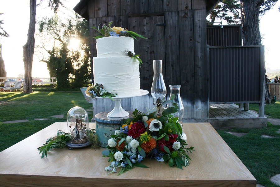 ELEGANT MUNCHIES This wedding cake looks normal enough, but on closer inspection you'll find marijuana leaves crawling up the side. - PHOTO BY HAYLEY THOMAS CAIN