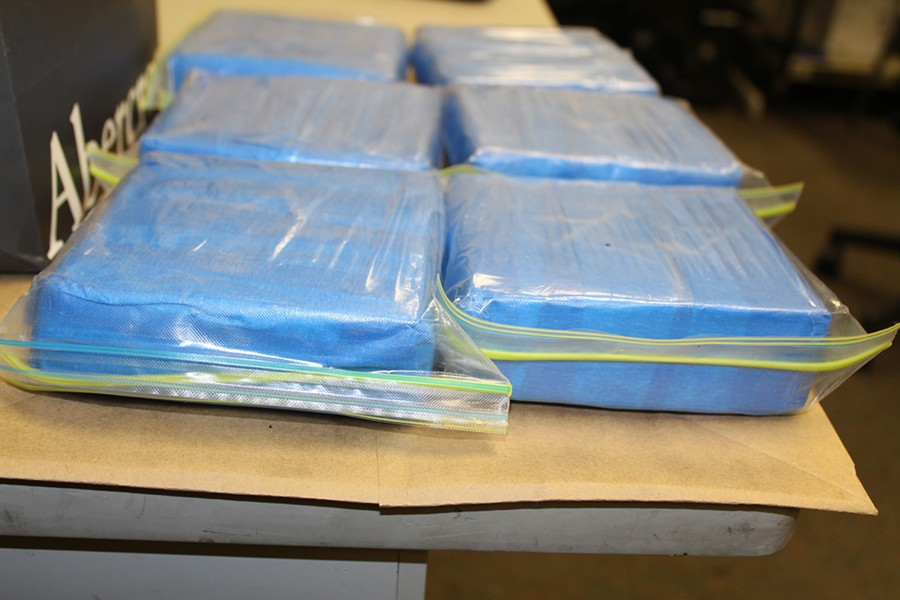 MOVING WEIGHT Law enforcement recovered an estimated 3 kilograms of cocaine during a July 2015 traffic stop of one of the drug ring's drivers. - PHOTO COURTESY OF SLO COUNTY SHERIFF'S OFFICE