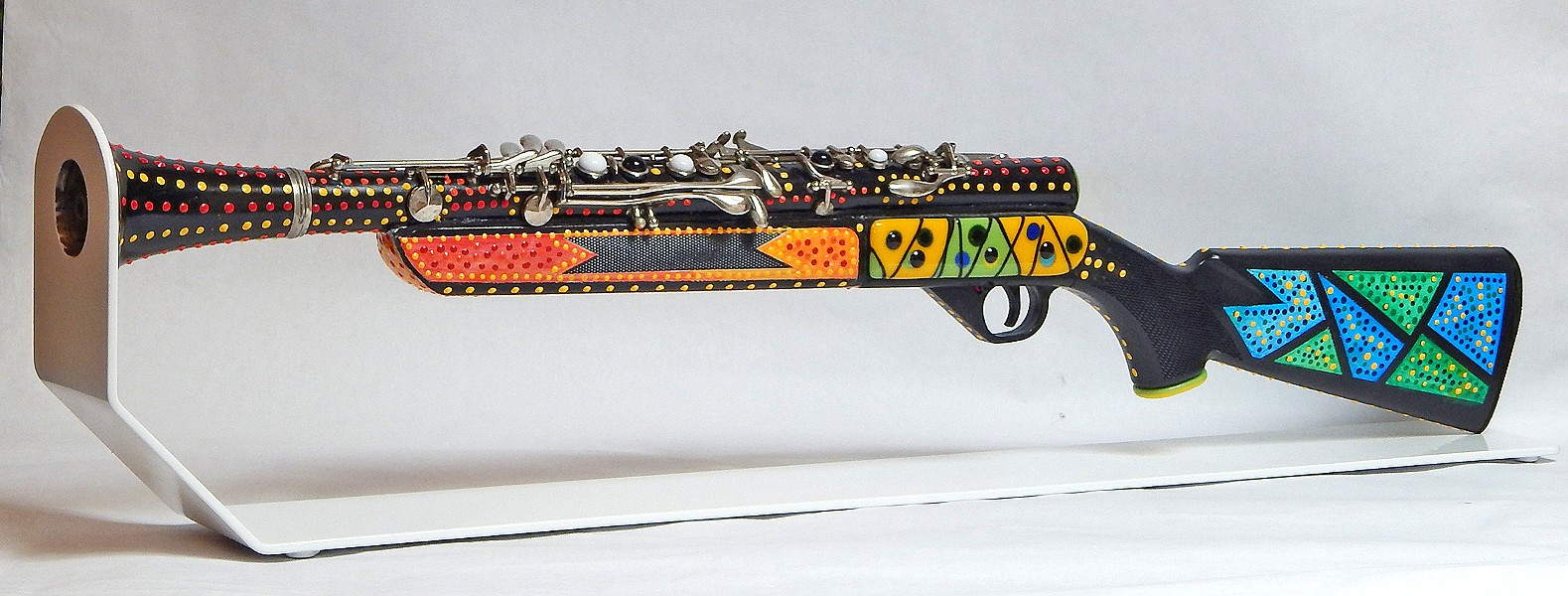 WEAPON OF GOOD Artist Larry Le Brane takes different pieces of clarinets and sculpts them into other things, like a gun, in Turn Instruments of Rage Into Instruments of Joy.  - IMAGE COURTESY OF LARRY LE BRANE