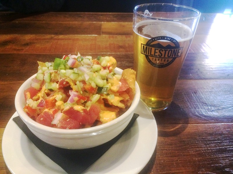 MILESTONE TAVERN Appetizers like poke nachos and local beer like Barrelhouse's Mango IPA is where it's at when dining at Milestone Tavern. - PHOTO BY RYAH COOLEY