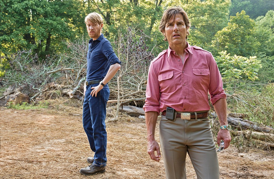 THE CIA AND THE RUBE CIA handler Monty Schafer (Domhnall Gleeson, left) recruits pilot Barry Seal (Tom Cruise) into working for the CIA in reconnaissance, gunrunning, and worse. - PHOTO COURTESY OF UNIVERSAL PICTURES