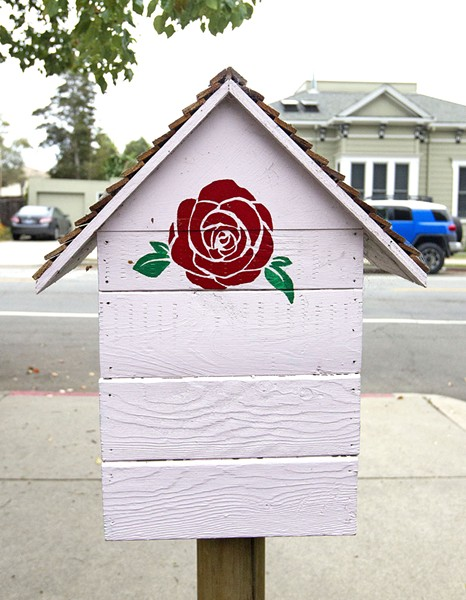 READING RED The Little Free Library in front of SLO Mayor Heidi Harmon's house in the downtown area is stamped with one of her iconic red roses. - PHOTO BY JAYSON MELLOM