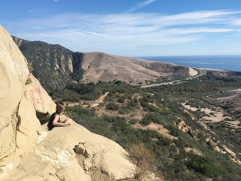 OCEAN FOR DAYS Highway 101 and the Pacific Ocean make for a pretty sweet sight from the wind caves above Gaviota State Park. - PHOTO BY CAMILLIA LANHAM