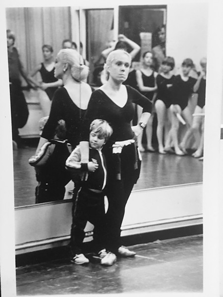 BACK IN THE DAY Lorilee Silvaggio pins down a squirming, young Drew Silvaggio while trying to teach dance class at Academy of Dance, SLO in its early days. - PHOTO COURTESY OF LORILEE SILVAGGIO