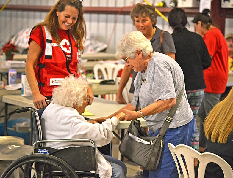 SAFE Charlotte Marchetti (left) and Carol Daly (right) reunite at a shelter after evacuating their homes in Ventura five days earlier. - PHOTO BY DERMOT TATLOW COURTESY OF THE RED CROSS