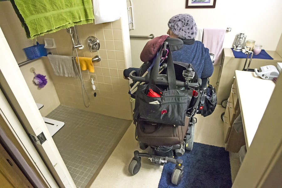 ACCESSIBLE HOME Ramirez showed New Times her wheelchair-accessible one-bedroom apartment, which she pays less than $300 in rent for. The Housing Authority of SLO recently filed for eminent domain to purchase the Brizzolara Apartments from AIG investors. - PHOTO BY JAYSON MELLOM