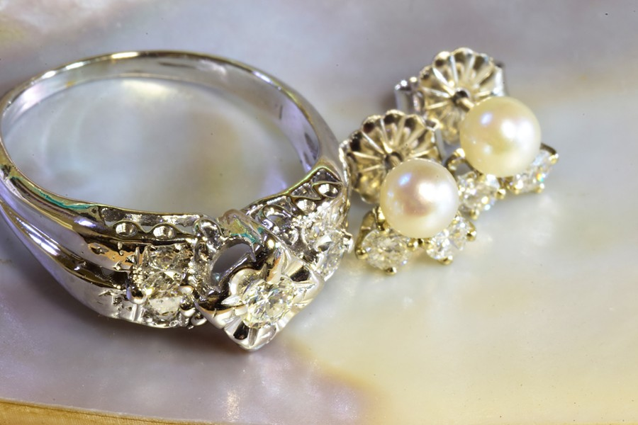 AFTER Upon lowering the center stone, bringing in two diamonds from the second ring, and fabricating new pieces to blend everything together, jewelers Amanda Stephens and David Hillebrecht had enough sparkly pieces leftover to make their client some new bridal earrings. - PHOTO COURTESY OF GARDEN STREET GOLDSMITHS