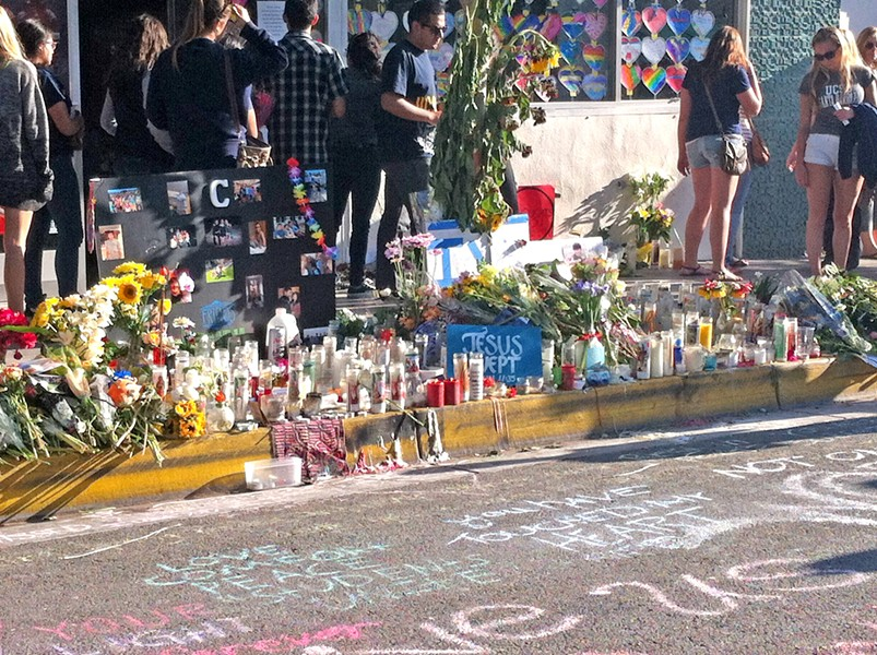 GRIEF ON DISPLAY Memorials took over the streets in Isla Vista after six people were stabbed and shot to death in May 2014. The massacre spurred the passage of new gun laws in California. - FILE PHOTO BY CHLOE RUCKER
