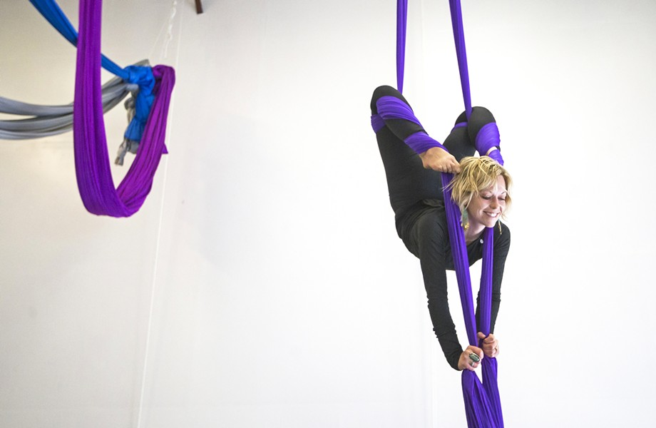 DANCE MEETS CIRCUS At Levity Academy in San Luis Obispo, co-owner Lei Lei de Kirby strives to blend dance and aerial arts on apparatuses like aerial fabric. - PHOTO BY JAYSON MELLON