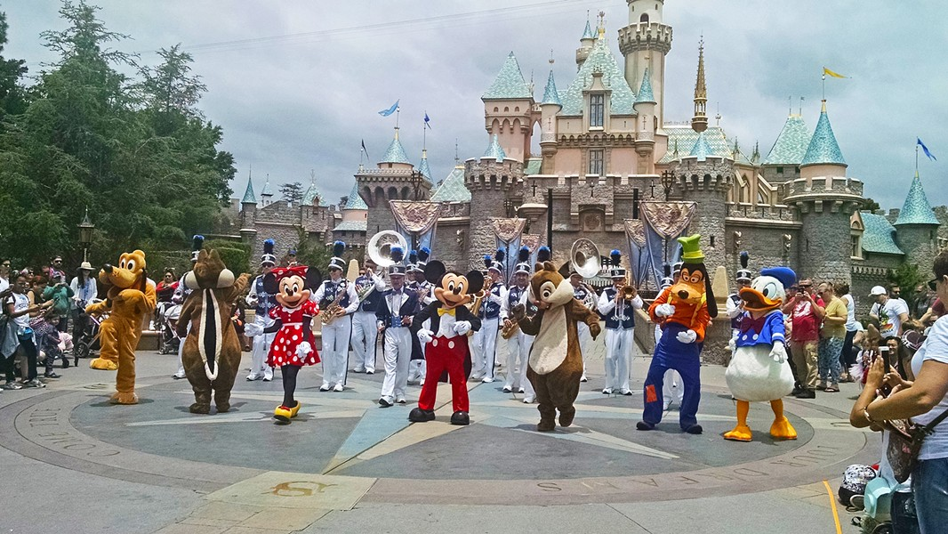 THE GANG'S ALL HERE Mickey, Minnie, Donald, Goofy, Pluto, Chip, and Dale dance their tails off in front of the Sleeping Beauty Castle. - PHOTO BY CALEB WISEBLOOD