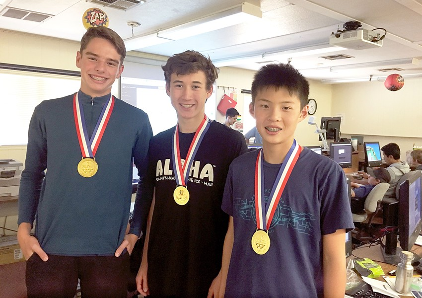 CRACKING CODES Grant Broersma, Christopher Dahl, and Edward Chiang (left to right) won the Cyber Patriot competition at Cuesta College's summer cyber camp. - PHOTO BY KAREN GARCIA