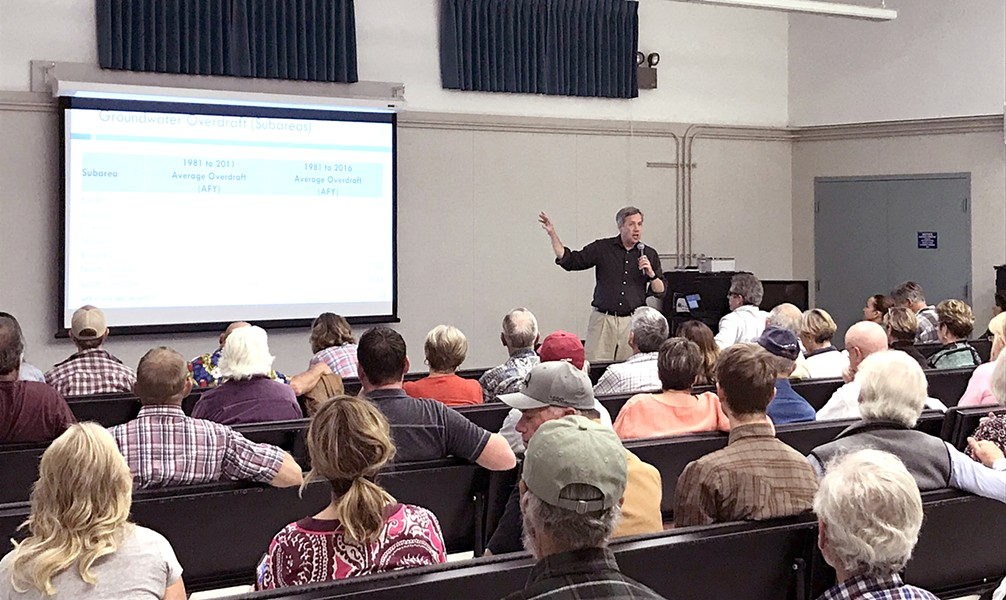 SETTING LEVELS Hydrologist Derrik Williams briefed several dozen Creston landowners on the area's groundwater conditions at an Oct. 8 workshop in Creston Elementary School. - PHOTO BY PETER JOHNSON
