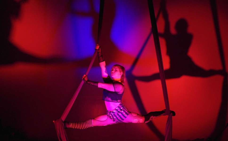 SEEING DOUBLE Aerialist Cheyenne Miller holds the splits on the aerial silks in preparation for the upcoming Halloween show, Welcome Stranger, at Levity Academy in SLO. - PHOTO COURTESY OF LEVITY ACADEMY