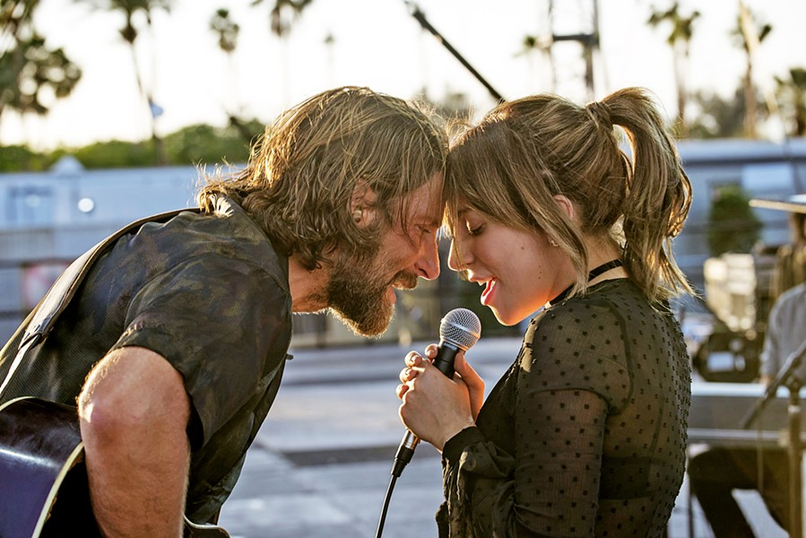 CROSSED TRAJECTORIES A seasoned performer near the end of his career (Bradley Cooper, left) discovers, nurtures, and falls in love with a talented newcomer (Lady Gaga) in A Star is Born. - PHOTO COURTESY OF WARNER BROS. PICTURES