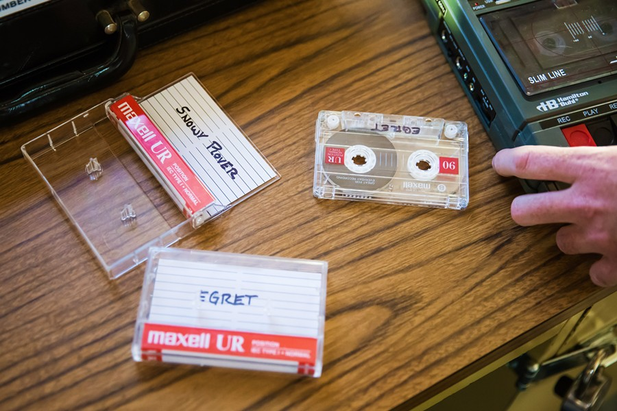 ESCAPE ARTISTS Escape rooms are designed to immerse players in a specific theme. The Lock Boxx, a SLO-based mobile escape room, is set in a kidnapped FBI agent's office, which is packed with clues such what's on these cassette tapes. - PHOTO BY JAYSON MELLOM