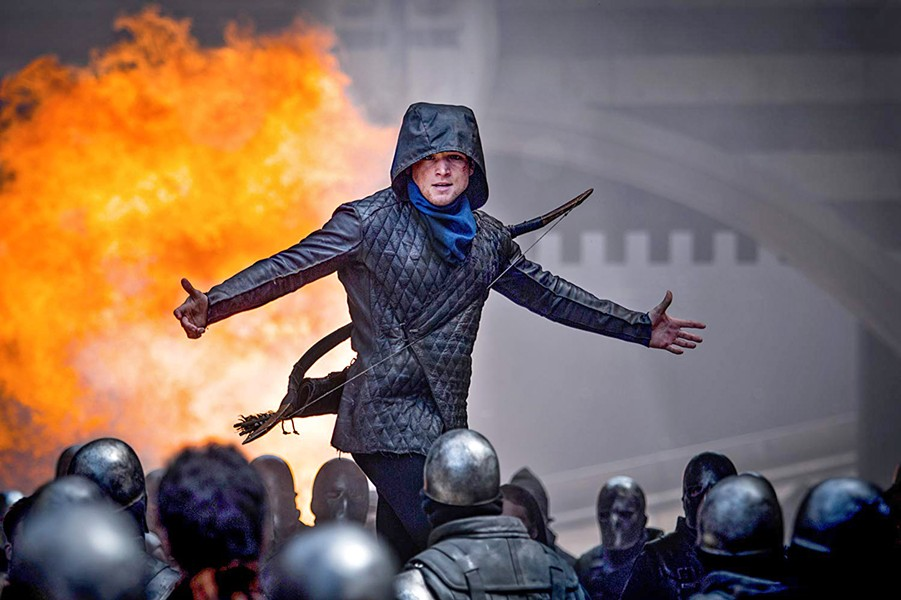 BOY IN A HOOD Former Crusader-turned-rebel Robin of Loxley (Taron Edgerton, right) takes on the corrupt British crown, in the spectacular and unnecessary Robin Hood. - PHOTO COURTESY OF LIONSGATE