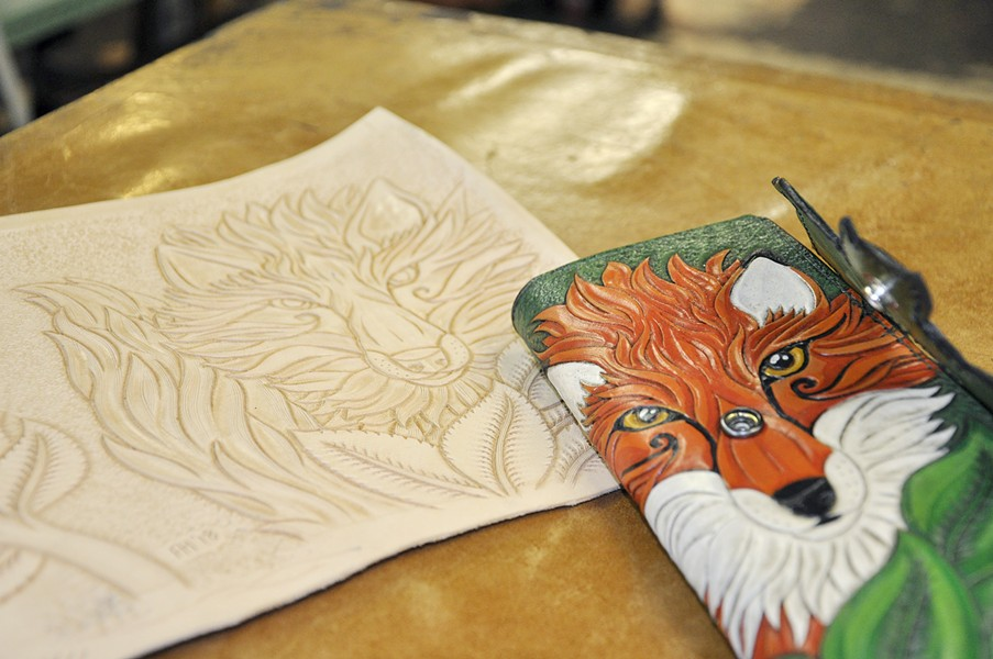FOXY LADY The Leather Shop owner and leathersmith Finn Hansen stamps, paints, and cuts images such as a fox and fern into leather to make women's wallets, journals, coin purses, and more. - PHOTO BY CAMILLIA LANHAM