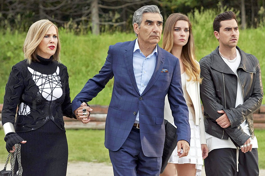 FISH OUT OF WATER The formerly wealthy Rose family—(left to right) mother Moira (Catherine O'Hara), father Johnny (Eugene Levy), and kids Alexis (Annie Murphy) and David (Dan Levy)—find themselves living in a backwater town, in the Canadian sitcom Schitt's Creek. - PHOTO COURTESY OF THE CANADIAN BROADCASTING CORPORATION
