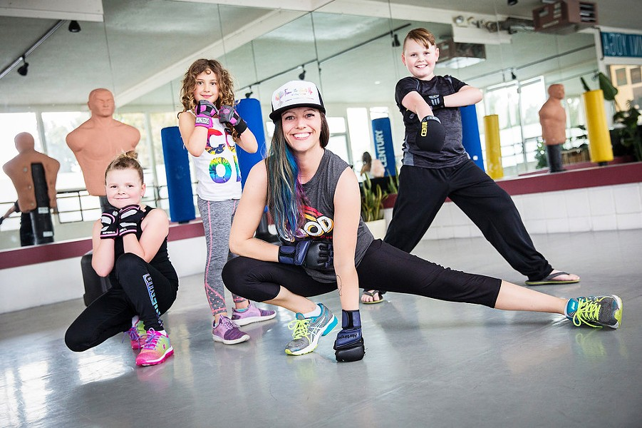 CENTERED Krista Rooney empowers the females in her community with her purposeful kickboxing classes. From left to right, Mikayla Rooney, Leona Pudarich, Krista Rooney, and Quinlan Rooney. - PHOTO COURTESY OF FROM THE ROOTS UP HEALING SERVICES