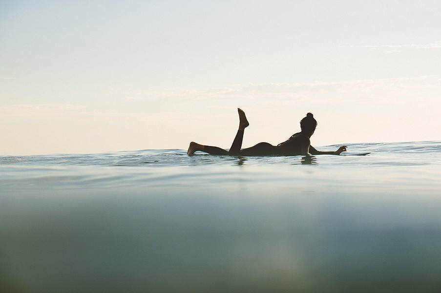 UP CLOSE While catching someone shredding a gnarly wave is all well and good, local photographer and surfer Colin Nearman prefers to capture those quiet little moments, like a lone surfer bobbing along the waves after a day spent surfing. - PHOTOS COURTESY OF COLIN NEARMAN