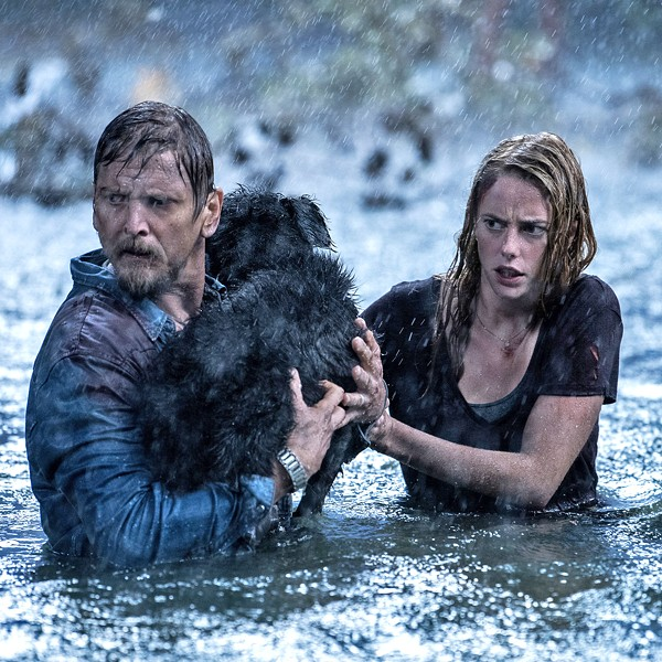 SURVIVE During a hurricane, Haley Keller (Kaya Scodelario, right) returns home to save her father, Dave (Barry Pepper), and the family dog but discovers floodwaters are infested with alligators, in Crawl. - PHOTO COURTESY OF PARAMOUNT PICTURES