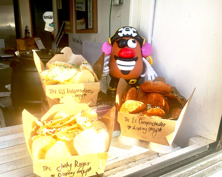 """POSING POTATO HEAD Mr. Potato Head doesn't just pose with Chipwrecked's chips. He has made an appearance in many of owner Sarah Paddack's photos, including taking the forefront of several snapshots from a recent trip to Europe: """"He goes everywhere with us now,"""" Paddack said. """"We just took him to the drive-in the other night."""" - PHOTOS BY BETH GIUFFRE"""