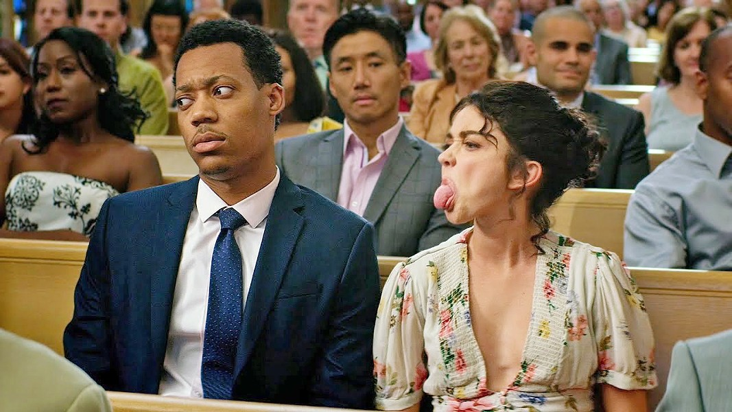 LOVE AND MARRIAGE Committment-phobe Mara Hickey (Sarah Hyland, right) finds her relationship with boyfriend Jake Riddick (Tyler James Williams) tested when they're invited to multiple weddings over the course of a year, in The Wedding Year. - PHOTO COURTESY OF LAKESHORE ENTERTAINMENT