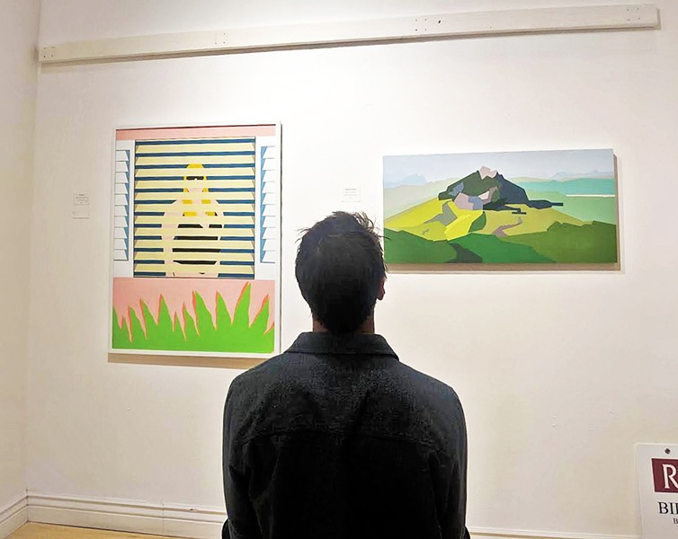 FAMILIAR SIGHTS A gallerygoer observes a featured painting that captures San Luis Obispo's iconic mountains. - PHOTOS COURTESY OF EDEL MITCHELL