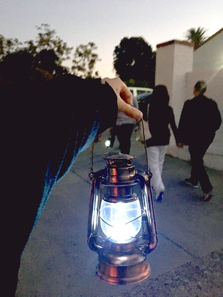 FOLLOW THE LIGHT Talking about ghosts feels even more authentic with one of these battery-powered, oil lamp lookalikes lighting your path. - PHOTOS BY KASEY BUBNASH