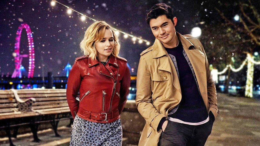 DECK THE HALLS Dysfunctional Kate (Emilia Clarke, left) works as Santa's elf at a year-round Christmas store, but when she meets Tom (Henry Golding), her life takes an unexpected turn, in the rom-com Last Christmas. - PHOTO COURTESY OF CALAMITY FILMS