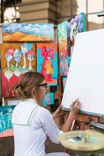 PAINTER'S ALLEY Local artist Jami Ray and her collective, Lamp Light Arts, practice live painting at venues around town, including occasionally at SLO's Downtown Farmers' Market. Here Ray paints on Garden Street. - PHOTO COURTESY OF IVAN DITSCHEINER