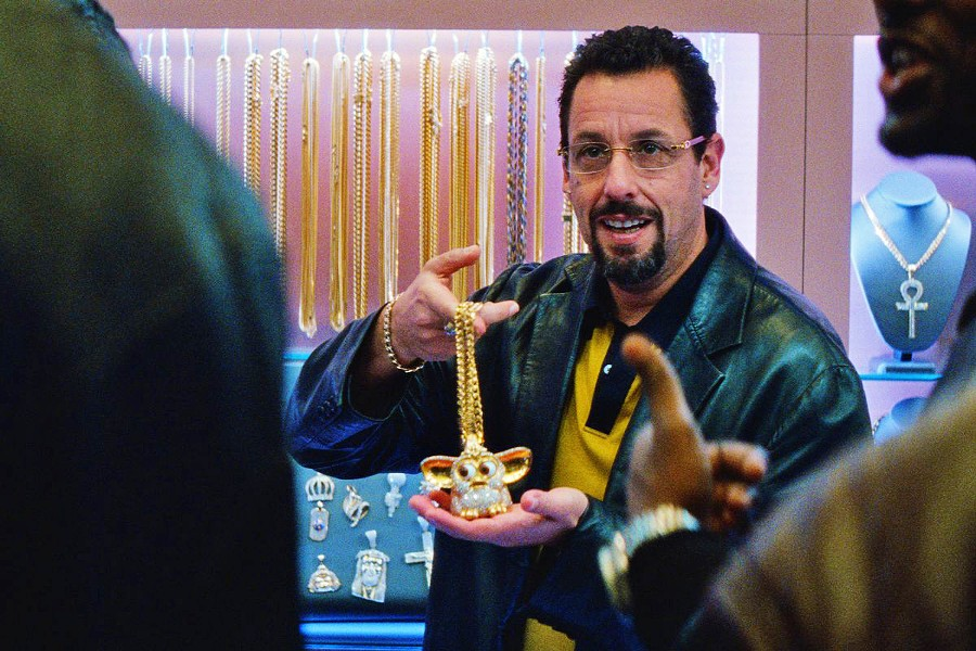 """DIAMOND IN THE ROUGH Reckless jeweler Howard """"Howie"""" Ratner (Adam Sandler) makes a series of high-stakes bets that could lead to the windfall of a lifetime or threaten to disrupt his business, family life, and well-being. - PHOTOS COURTESY OF A24"""