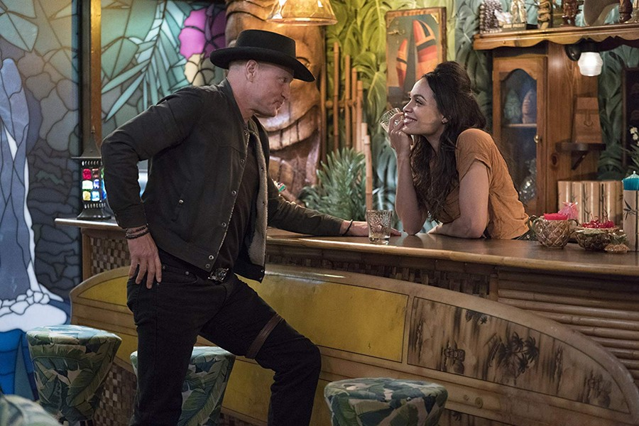 A MATCH MADE IN HELL Tallahassee (Woody Harrelson) meets Nevada (Rosario Dawson) in 2019's hilarious horror-comedy Zombieland: Double Tap, available in Redbox. - PHOTO COURTESY OF COLUMBIA PICTURES